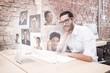 Composite image of businessman using computer at desk