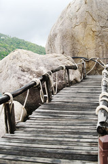 Plank bridge  and huge stones boulders, Koh Nanguan, Thailand
