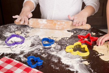 child cut out cookies for baking