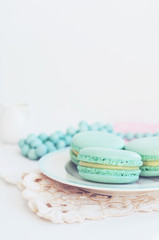 Backdrop with minty macaroon on light background