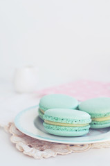 Backdrop with mint macaroon on light background
