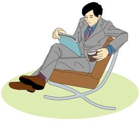お疲れビジネスパーソン-雑誌を読む男性会社員