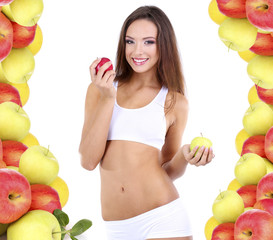 Beautiful young woman with apples isolated