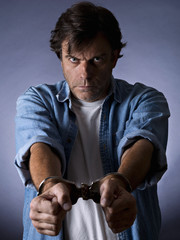Man, mature, with handcuffs on