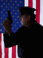 Silhouette of a policeman with the handgun