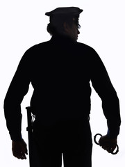 Silhouette of police officer with handcuffs in hand