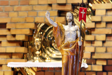 Wooden figure of Jesus resurrected, in the church during Easter