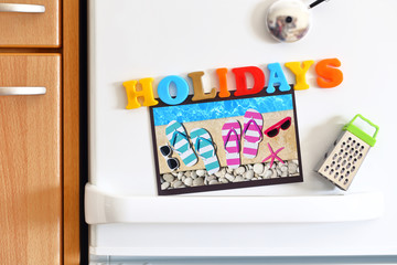 Refrigerators door with text Holidays and Photo By The Pool