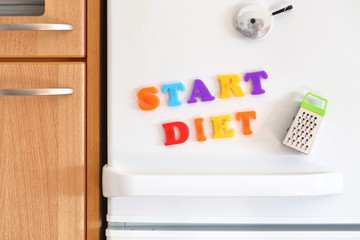 Refrigerators door with colorful text Start Diet