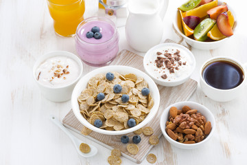 crunchy flakes with blueberries and various yogurts