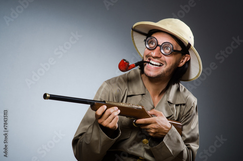 Hunter with rifle and smoking pipe - 78435113