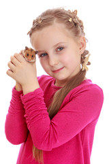 Charming girl holding a hamster in his fist.