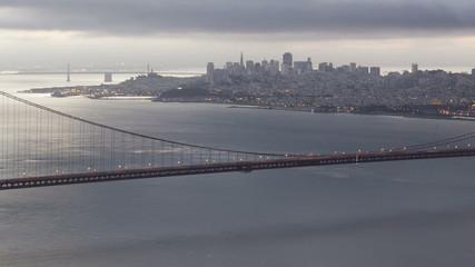 Time lapse sunrise close up pan shot Golden Gate Bridge