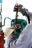 Man work a propane tank poster