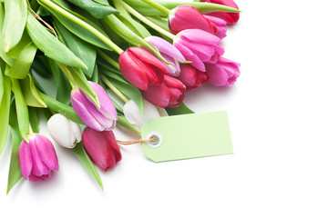Bouquet of tulips with an empty tag isolated on white background
