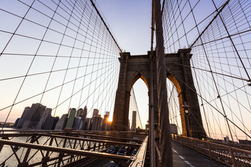 Brooklyn Bridge sunset with Manhattan skyline US
