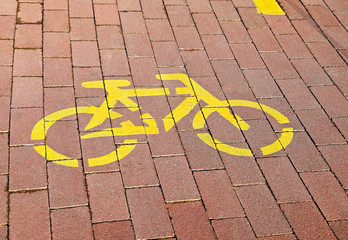 Bicycle sign on the paving stones of the bicycle road