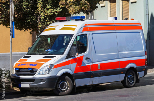 Ambulance is waiting on the street - 78438995