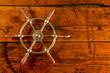 Brass Ship Wheel on Textured Wood - 78439354