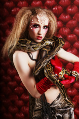burlesque woman holding phyton