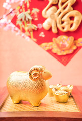 Ceramic goat souvenir on red paper