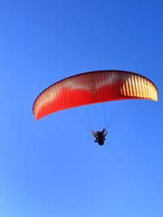 Para motor glider in blue sky under sun light