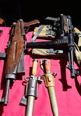 Old machine guns and bayonets