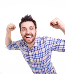 Casual man winning and celebrating on white background