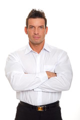 Portrait of handsome thinking businessman in white shirt