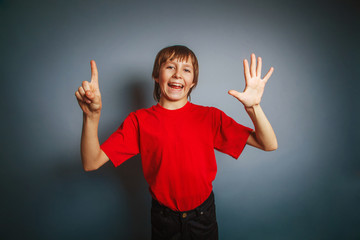 European-looking boy of ten years shows a figure six fingers on