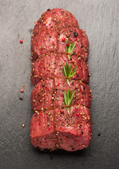 Roast beef with spices and rosemary. top view