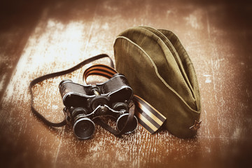 Military binoculars, soldier field cap, George Ribbon