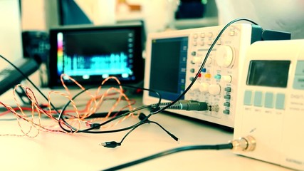 electronic components and oscilloscope in laboratory