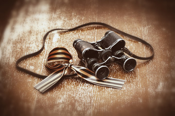 George Ribbon and military binoculars