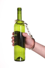 bottle alcohol and handcuffs, Drunk driving concept, alcoholism