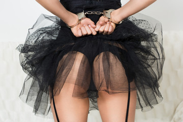 girl in handcuffs standing back. visible ass