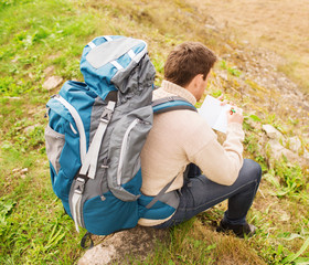 man with backpack hiking