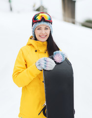 happy young woman with snowboard outdoors