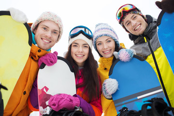 happy friends with snowboards