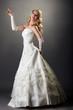 canvas print picture - Lovely blonde posing in elegant wedding dress