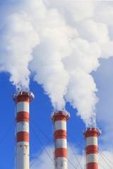 Dense smoke from boiler room pipes