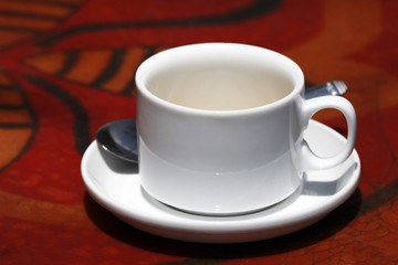 White cup and spoon