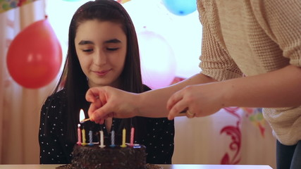 Young girl enjoying birthday cake and candles