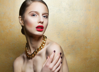 Luxury glaumor woman with perfect make up and golden necklace.