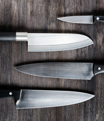 Knives on wooden board