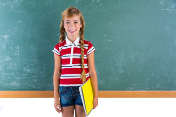 Blond braid schoolgirl with student spiral notebook