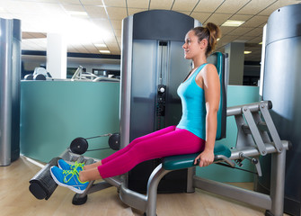 Calf extension woman at gym exercise machine