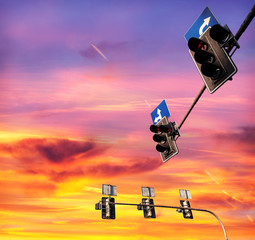 Traffic lights against cloudy sky at sunset, text space.