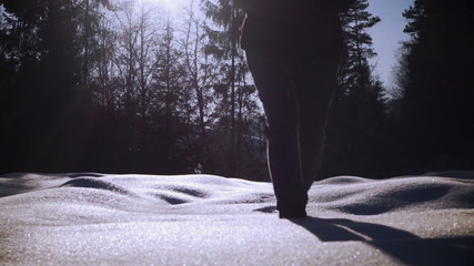 Woman walking in the deep snow, steadycam shot, slow motion shot