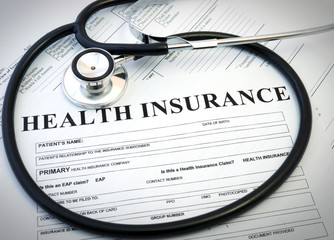 Health insurance form with stethoscope